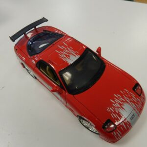 https://militaryhobbies.com.au/wp-content/uploads/2020/04/118-scale-Diecast-1993-Mazda-RX7-DOMS-Fast-Furious-293174603926.jpg